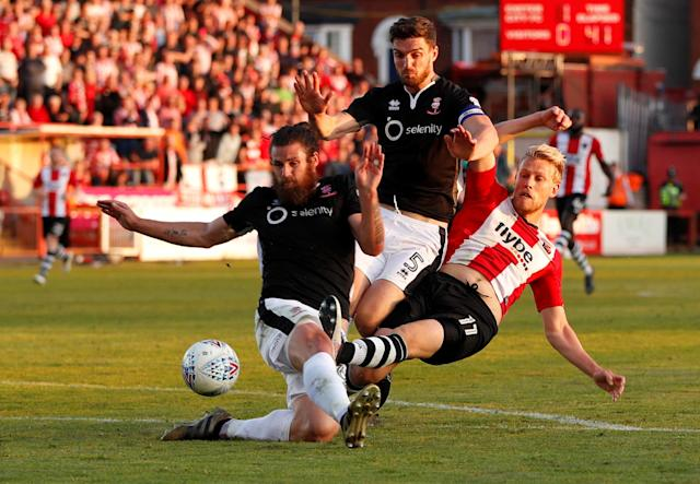 "Soccer Football - League Two Play Off Semi Final Second Leg - Exeter City vs Lincoln City - St James Park, Exeter, Britain - May 17, 2018 Exeter City's Jayden Stockley in action with Lincoln City's Michael Bostwick and Luke Waterfall Action Images/Paul Childs EDITORIAL USE ONLY. No use with unauthorized audio, video, data, fixture lists, club/league logos or ""live"" services. Online in-match use limited to 75 images, no video emulation. No use in betting, games or single club/league/player publications. Please contact your account representative for further details."