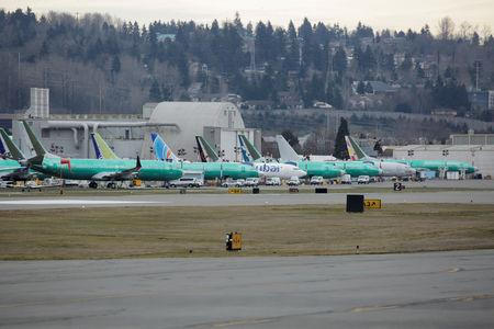 FILE PHOTO: Boeing 737 MAX aircraft are parked at a Boeing production facility in Renton, Washington, U.S., March 11, 2019. REUTERS/David Ryder/File Photo
