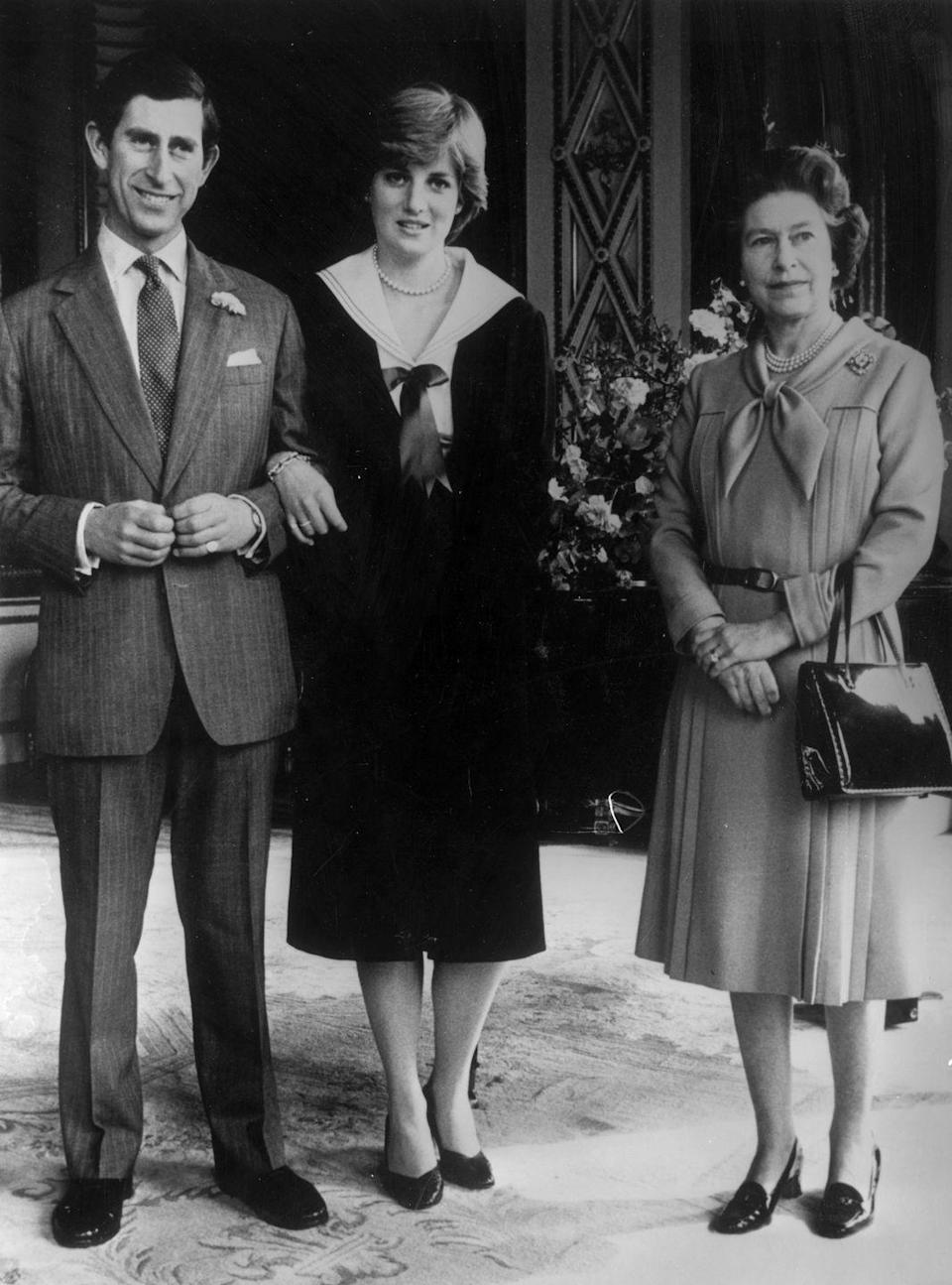 <p>Prince Charles and Diana pose with Queen Elizabeth II at Buckingham Palace after she gave her consent for their wedding.</p>