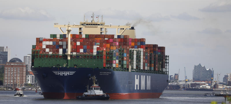 HAMBURG, GERMANY - JUNE 10: The HMM Algeciras, currently the world's largest container ship, departs from Hamburg Port during the novel coronavirus pandemic on June 10, 2020 in Hamburg, Germany. According to Germany's Federal Statistics Bureau Germany's total exports fell by 31% in April as compared to one year ago. Lockdown measures have since largely eased and most factories have resumed production, though supply chains remain fractured. The Algeciras is 399.9 meters long and 61 meters wide, and has a nominal capacity to transport 23,964 containers. It is the first in a series of twelve ships in the 24,000 TEU class and was built in South Korea. (Photo by Morris MacMatzen/Getty Images)