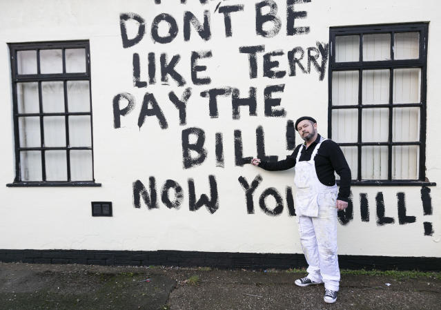 Painter and decorator, Dean Reeves 50, painted black graffiti on a house accusing the owner of not paying him, pictured in Bolsover in Derbyshire (SWNS)