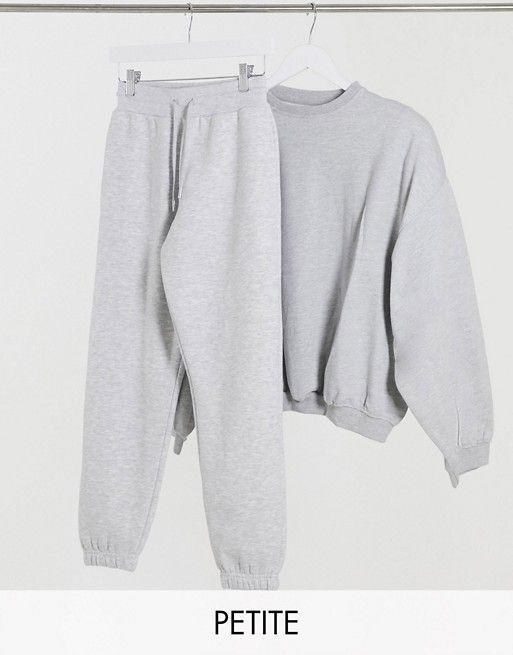 """<p><strong>Collusion</strong></p><p>us.asos.com</p><p><strong>$19.00</strong></p><p><a href=""""https://go.redirectingat.com?id=74968X1596630&url=https%3A%2F%2Fwww.asos.com%2Fus%2Fcollusion%2Fcollusion-petite-skinny-sweatpants-in-gray%2Fprd%2F14320593&sref=https%3A%2F%2Fwww.goodhousekeeping.com%2Fclothing%2Fg35044369%2Fbest-matching-sweatsuits-women%2F"""" rel=""""nofollow noopener"""" target=""""_blank"""" data-ylk=""""slk:Shop Now"""" class=""""link rapid-noclick-resp"""">Shop Now</a></p><p>Sweats can be tricky for women on the shorter side because of the extra material. However, ASOS has a wide range of petite sweats, like these Collusion pieces. <strong>The pants feature a drawstring waist and fitted cuffs</strong>. <br></p>"""