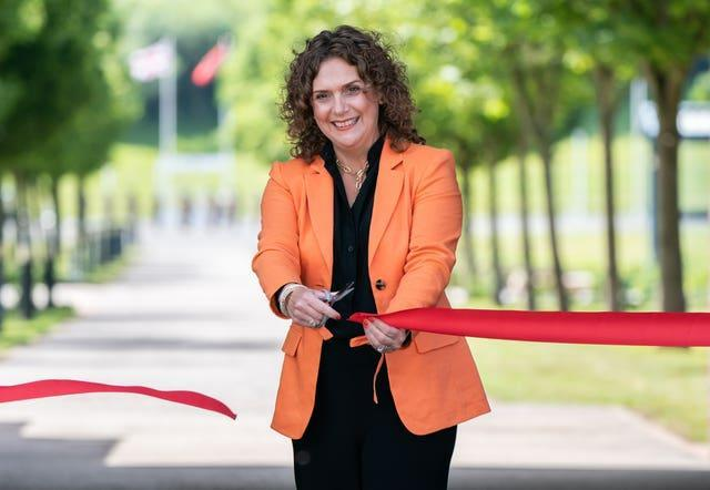 Captain Sir Tom Moore's daughter Hannah Ingram-Moore cuts a ribbon to officially open the walkway