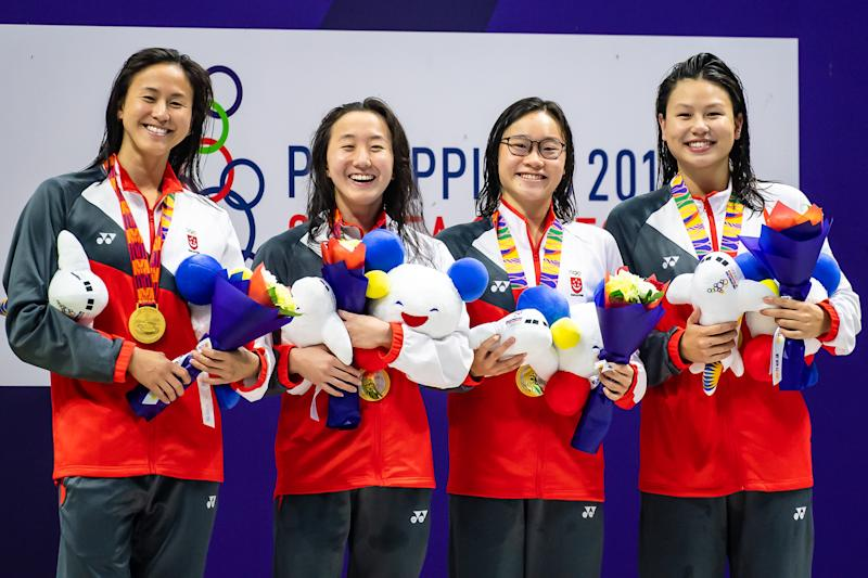 Singapore's gold-winning women's 4x200m freestyle team at the SEA Games: (from left) Quah Ting Wen, Quah Jing Wen, Gan Chin Hwee, Christy Chue. (PHOTO: SNOC/Andy Chua)