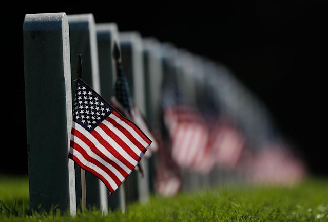 <p>Decorated to mark the Memorial Day holiday, American flags adorn the headstones in Fort Logan National Cemetery on May 28, 2017, in southwest Denver. (Photo: David Zalubowski/AP) </p>