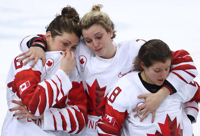 <p>Canadian players win silver medals as they lose the women's final ice hockey match against the United States as part of the 2018 Winter Olympic Games at the Gangneung Hockey Centre with a 2-3 score. Valery Sharifulin/TASS </p>