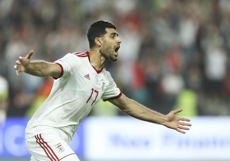 Iran's forward Mehdi Taremi celebrates after he scored first goal during the AFC Asian Cup quarterfinal soccer match between Iran and China at Mohammed Bin Zayed Stadium in Abu Dhabi, United Arab Emirates, Thursday, Jan. 24, 2019. (AP Photo/Kamran Jebreili)