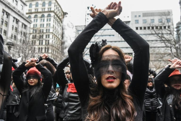 """NEW YORK, NY - JANUARY 10 : Women inspired by the Chilean feminist group called Las Tesis perform """"the rape dance"""" in front of the New York City criminal court during Harvey Weinstein's sex crimes trial on January 10, 2020 in New York City. Weinstein, a movie producer whose alleged sexual misconduct helped spark the #MeToo movement, pleaded not-guilty on five counts of rape and sexual assault against two unnamed women and faces a possible life sentence in prison. Stephanie Keith/Getty Images/AFPNEW YORK, NY - JANUARY 10 : Women inspired by the Chilean feminist group called Las Tesis perform """"the rape dance"""" in front of the New York City criminal court during Harvey Weinstein's sex crimes trial on January 10, 2020 in New York City. Weinstein, a movie producer whose alleged sexual misconduct helped spark the #MeToo movement, pleaded not-guilty on five counts of rape and sexual assault against two unnamed women and faces a possible life sentence in prison. Stephanie Keith/Getty Images/AFP"""