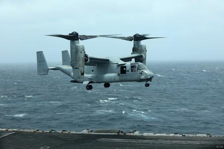 An MV-22 Osprey aircraft lands on the deck of USS Abraham Lincoln the Gulf of Oman near the Strait of Hormuz