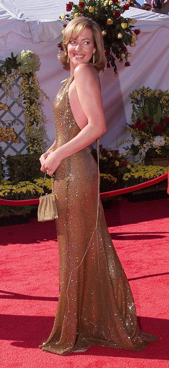 """<p>Janney wore a knockout gold dress when she won the Emmy for Outstanding Supporting Actress in a Drama Series <span class=""""redactor-invisible-space"""">for her role on <em>The West Wing</em><span class=""""redactor-invisible-space""""> in</span></span> 2000.</p>"""