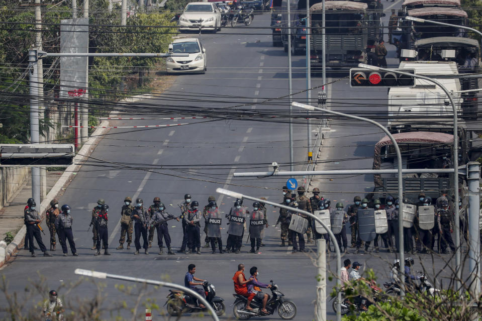 Police stand in formation blocking a main road in Mandalay, Myanmar, Saturday, Feb. 27, 2021. Myanmar security forces cracked down on anti-coup protesters in the country's second-largest city Mandalay on Friday, injuring at least three people, two of whom were shot in the chest by rubber bullets and another who suffered a wound on his leg. (AP Photo)