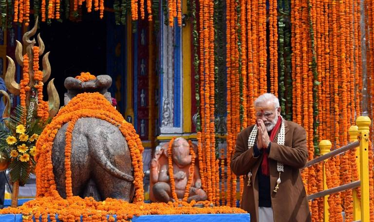 <p>In this photograph released by India's Press Information Bureau on May 3, 2017, Indian Prime Minister Narendra Modi gestures during a visit to the Kedarnath Temple in Uttarakhand. </p>