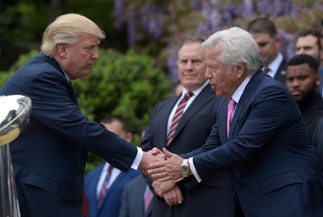 President Donald Trump, shaking hands with New England Patriots owner Robert Kraft in 2017, was in a selfie with the founder of the Orchids of Asia Day Spa during a Super Bowl party in Florida. (AP)