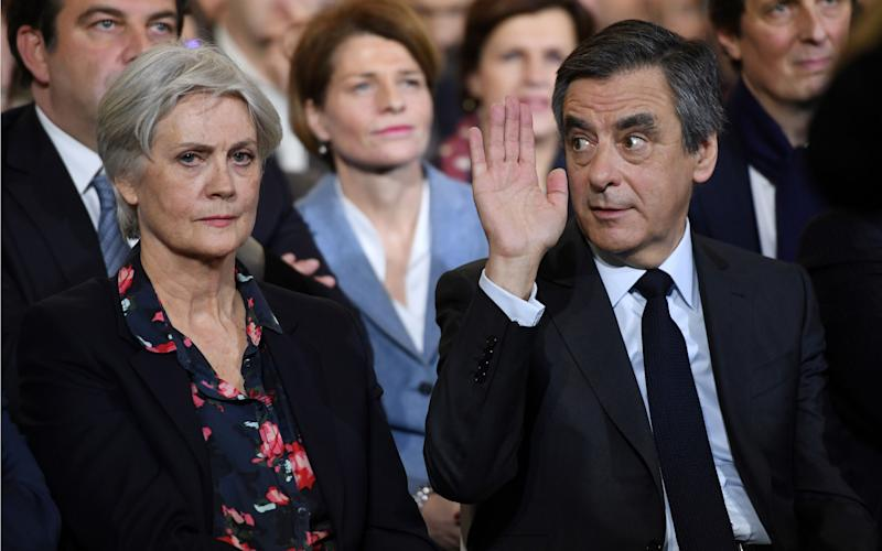French right wing candidate for the upcoming presidential election Francois Fillon (R), flanked by his wife Penelope Fillon - Credit: ERIC FEFERBERG/AFP