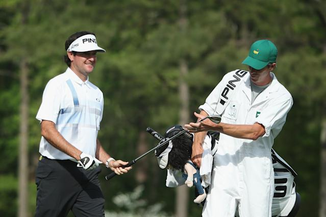 AUGUSTA, GA - APRIL 13: Bubba Watson of the United States gives a club to his caddie Ted Scott on the 12th tee during the final round of the 2014 Masters Tournament at Augusta National Golf Club on April 13, 2014 in Augusta, Georgia. (Photo by Andrew Redington/Getty Images)