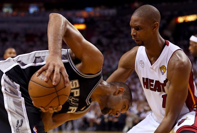 MIAMI, FL - JUNE 18: Tim Duncan #21 of the San Antonio Spurs looks to drive on Chris Bosh #1 of the Miami Heat during Game Six of the 2013 NBA Finals at AmericanAirlines Arena on June 18, 2013 in Miami, Florida. NOTE TO USER: User expressly acknowledges and agrees that, by downloading and or using this photograph, User is consenting to the terms and conditions of the Getty Images License Agreement. (Photo by Mike Ehrmann/Getty Images)
