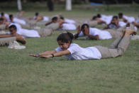 Special police officer recruits who completed nearly three months physical training perform yoga at Kathua in Indian-controlled Kashmir, Saturday, June 5, 2021. Special police officers are lower-ranked police officials who are mainly recruited for intelligence gathering and counterinsurgency operations. In recent years, the force has assisted in border areas as well because of local recruits' familiarity with the topography and ability to assist police and border guards during emergencies. (AP Photo/Channi Anand)