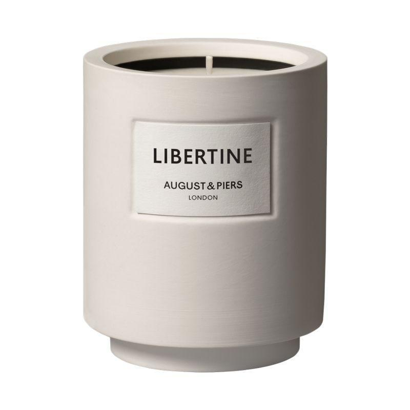 """<p>August & Piers Libertine </p><p>£59</p><p>Augustpiers.com</p><p><a class=""""link rapid-noclick-resp"""" href=""""https://www.augustpiers.com/products/libertine"""" rel=""""nofollow noopener"""" target=""""_blank"""" data-ylk=""""slk:SHOP NOW"""">SHOP NOW</a></p><p>It won't take long for August & Piers' candles to become as coveted as those fine-fragrance behemoths (you know the ones). Brand new, yet already settled on Rosie Huntington-Whiteley's very chic shelves, these minimalist votives burn with unique, thoughtful and intriguing scents. Our pick is Libertine, which blends smoky woods with heady patchouli for maximum impact. </p>"""