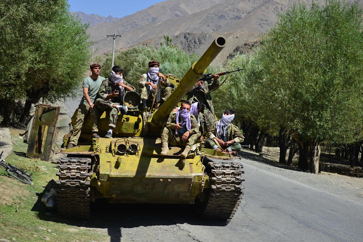 Afghan resistance movement and anti-Taliban uprising forces are pictured on a Soviet-era tank as they are deployed to patrol along a road in the Astana area of Bazarak in Panjshir province on August 27, 2021, as among the pockets of resistance against the Taliban following their takeover of Afghanistan, the biggest is in the Panjshir Valley. (Photo by Ahmad SAHEL ARMAN / AFP) (Photo by AHMAD SAHEL ARMAN/AFP via Getty Images)