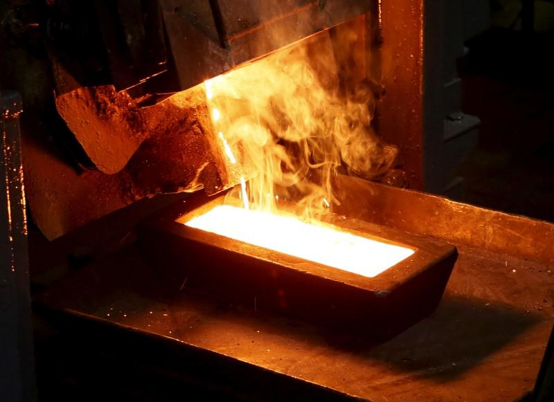 A melter casts an ingot of 92.96 percent pure gold at a procession plant of the Olimpiada gold operation in Krasnoyarsk region
