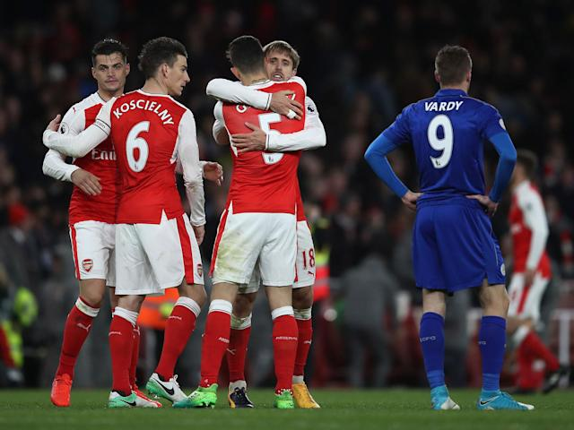 Arsenal's players celebrate after the final whistle: Getty