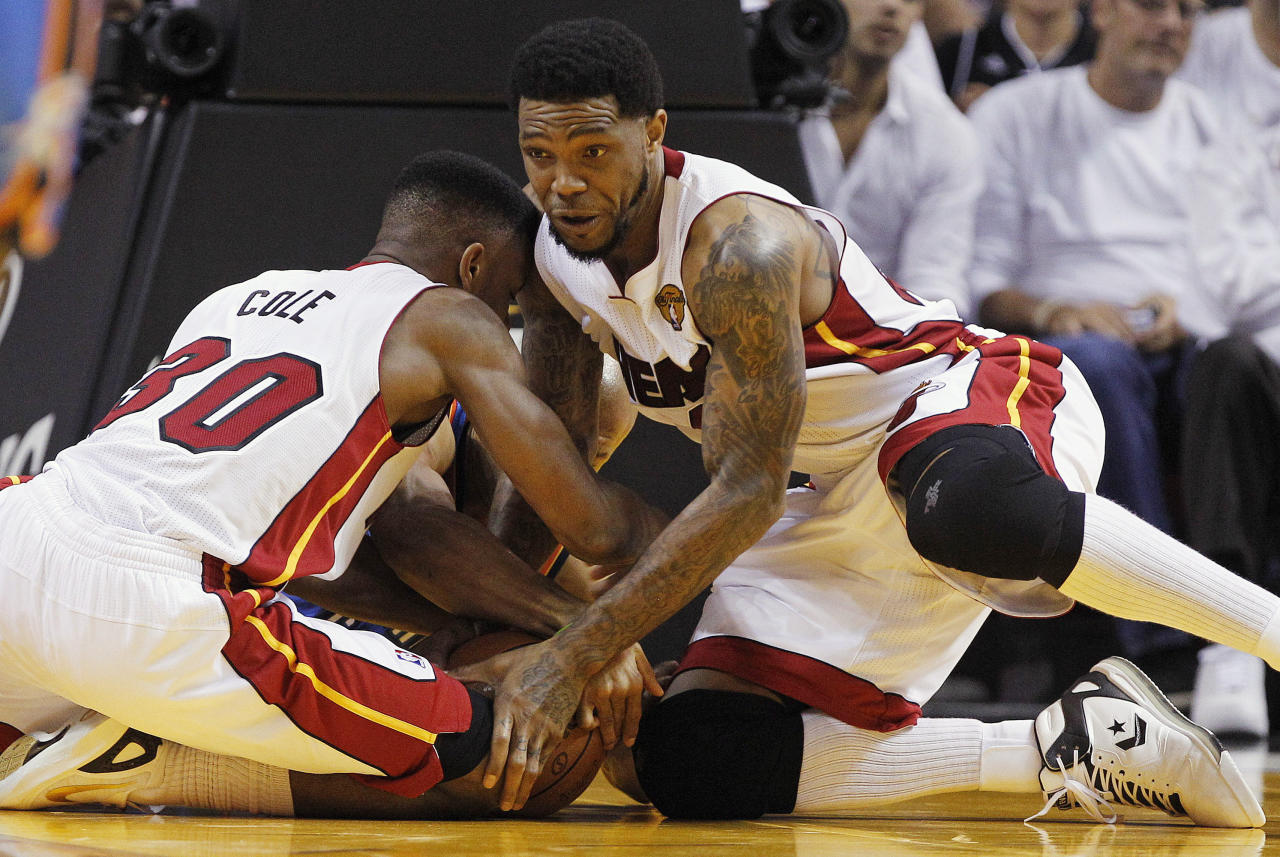 Miami Heat point guard Norris Cole (30), power forward Udonis Haslem, right, and Oklahoma City Thunder point guard Derek Fisher go after a loose ball during the first half of Game 4 of the NBA fFinals basketball series, Tuesday, June 19, 2012, in Miami. (AP Photo/Lynne Sladky)