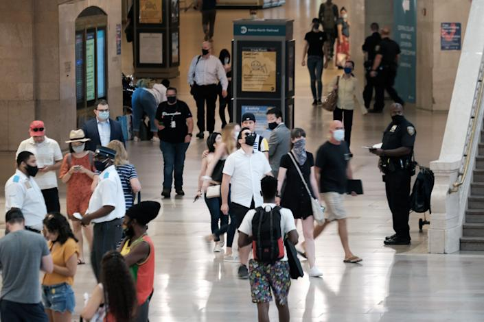 People wear masks in Grand Central Terminal in New York City on July 27. (Spencer Platt/Getty Images)