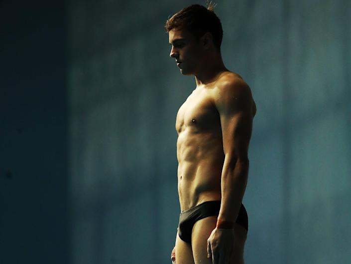 Tom Daley in a speedo ready to jump off diving board