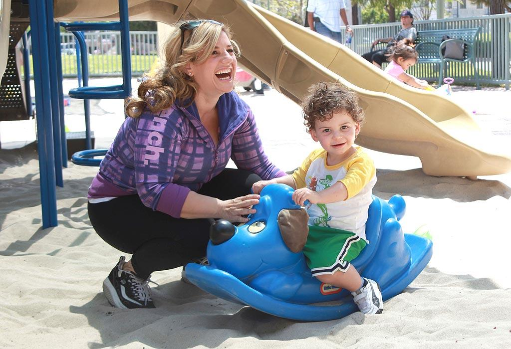 """""""Hairspray's"""" Marissa Jaret Winokur and her little boy Zev, 2, who was delivered via surrogate, also enjoyed a day at the park. """"I'm really shocked by how much I love being a mom,"""" she told BettyConfidential.com. """"I've always been so career-focused, and as an actress I'm used to everything being all about me. Now I'm all about my son. I actually find my career and so many other things quite trivial."""" Jen Lowery/<a href=""""http://www.splashnewsonline.com"""" target=""""new"""">Splash News</a> - May 9, 2010"""