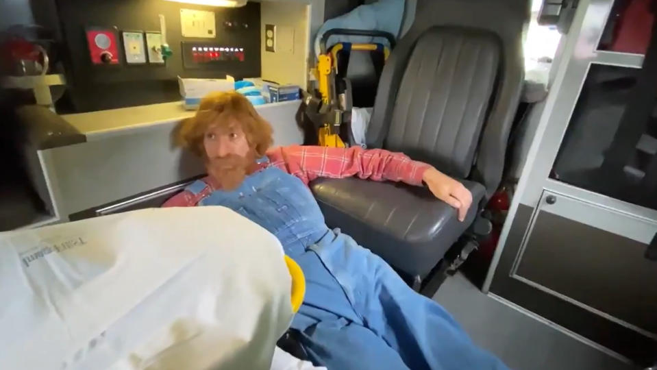 Sacha Baron Cohen takes refuge in a truck while filming 'Borat Subsequent Moviefilm'. (Credit: Sacha Baron Cohen/Twitter)