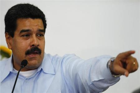 Venezuela's President Maduro talks to the media during a news conference in Caracas