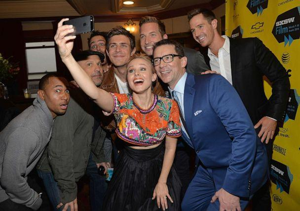 PHOTO: Kristen Bell poses for a selfie with cast members, from left, Percy Daggs, Enrico Colantoni, Chris Lowell, Ryan Hansen, Jason Dohring and director Rob Thomas at the premiere of 'Veronica Mars' during SXSW 2014. (Michael Buckner/Getty Images)
