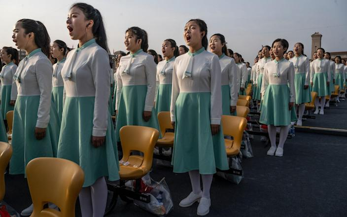 Women sing together at a ceremony