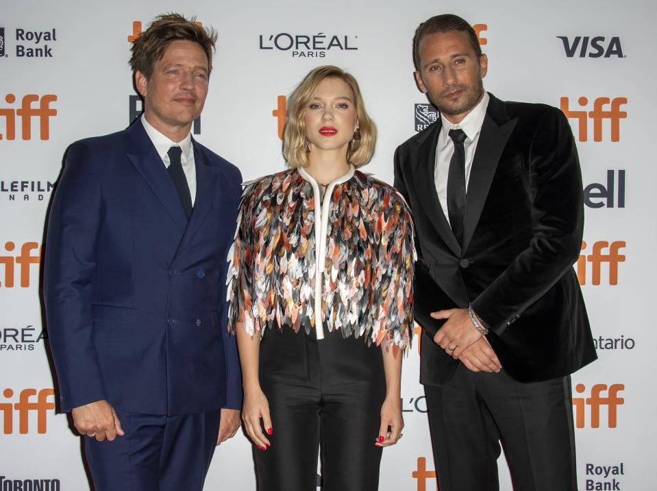 Director Thomas Vinterberg with Léa Seydoux in Louis Vuitton and Matthias Schoenaerts at the Kursk premiere at TIFF