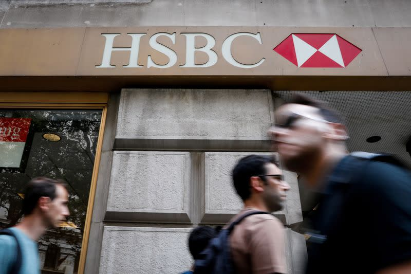 FILE PHOTO: People pass by an HSBC branch bank in the financial district in New York