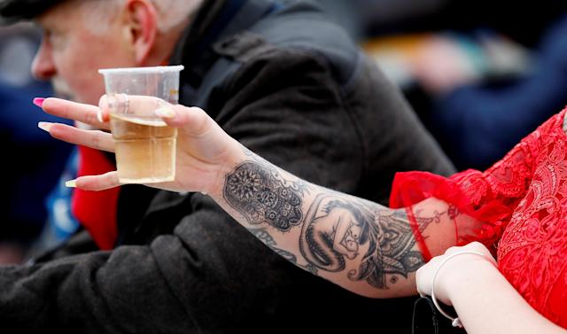 Horse Racing - Grand National Festival - Aintree Racecourse, Liverpool, Britain - April 12, 2018 General view of a racegoer's tattoo during the Grand National Festival Action Images via Reuters/Jason Cairnduff