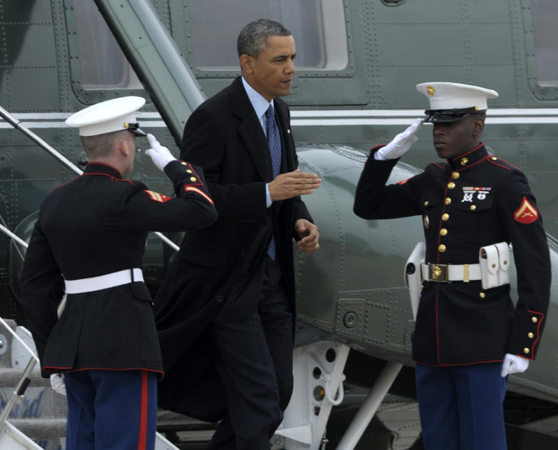 President Barack Obama walks off the Marine One helicopter to head to Air Force One at Andrews Air Force Base, Md., Tuesday, Feb. 26, 2013. The president is traveling to Newport News, Va., for an event on the automatic budget cuts.  (AP Photo/Susan Walsh)