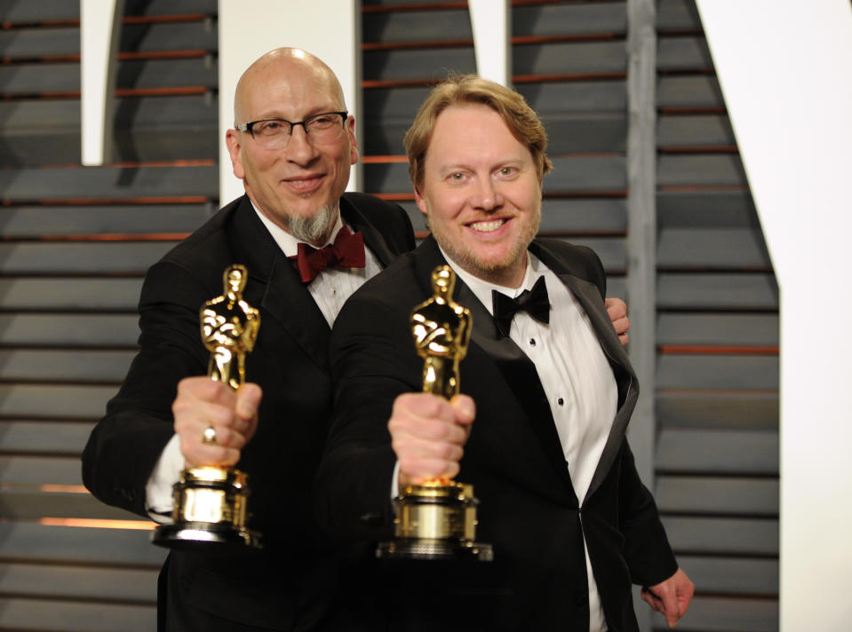 "Roy Conli, left, and Don Hall pose backstage with their award for best animated feature film for ""Big Hero 6"" arrives at the 2015 Vanity Fair Oscar Party on Sunday, Feb. 22, 2015, in Beverly Hills, Calif. (Photo by Evan Agostini/Invision/AP)"
