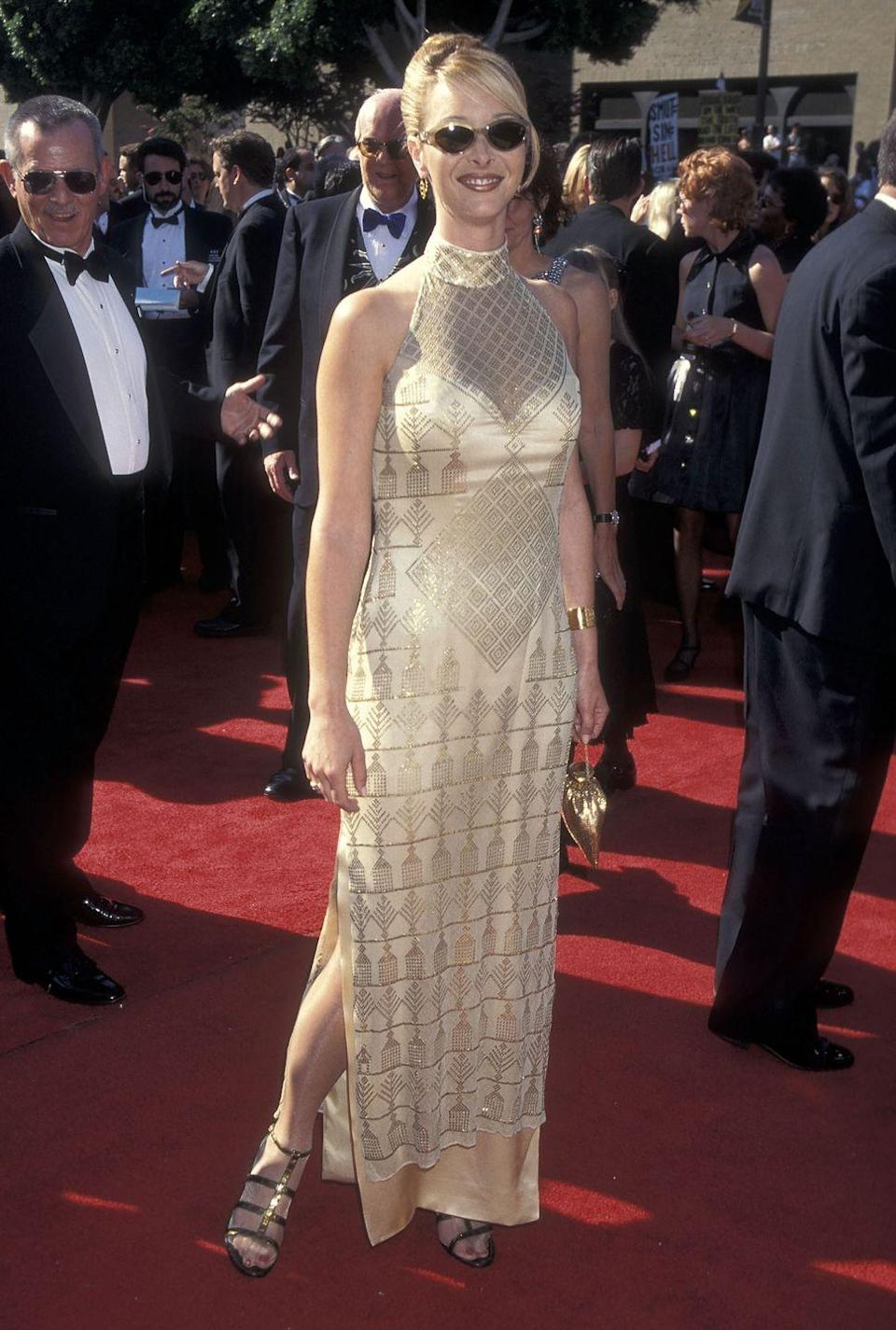 <p>Kudrow wore shades and a gold dress to the Emmy Awards in 1995. </p>