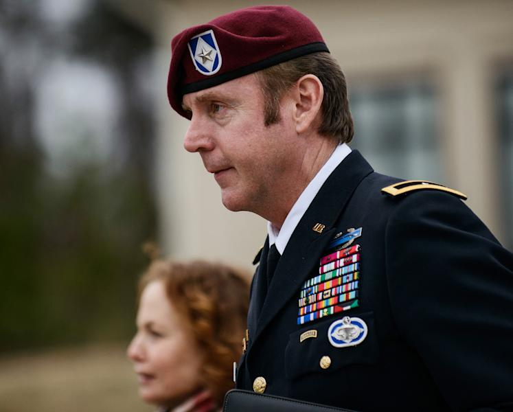 FILE - In this March 4, 2014, file photo, Brig. Gen. Jeffrey Sinclair leaves the courthouse following a day of motions at Fort Bragg, N.C. A military judge declined Monday, March 10, 2014, to dismiss sexual assault charges against Sinclair after reviewing what he said was evidence that political considerations influenced the military's handling of the case. (AP Photo/The Fayetteville Observer, James Robinson, File)