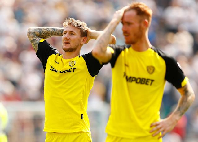 "Soccer Football - Championship - Preston North End vs Burton Albion - Deepdale, Preston, Britain - May 6, 2018 Burton Albion's Kyle McFadzean and Tom Naylor look dejected at full time Action Images/Jason Cairnduff EDITORIAL USE ONLY. No use with unauthorized audio, video, data, fixture lists, club/league logos or ""live"" services. Online in-match use limited to 75 images, no video emulation. No use in betting, games or single club/league/player publications. Please contact your account representative for further details."