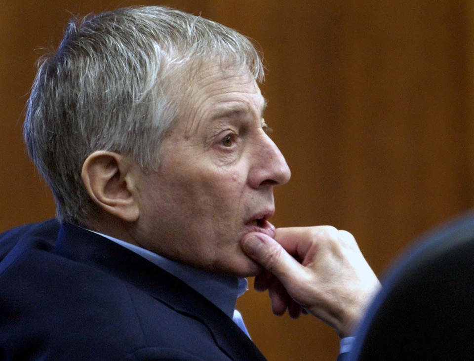 FILE - In this Friday, Sept. 19, 2003, file photo, Robert Durst sits in the courtroom as attorneys meet with the judge in chambers in Galveston, Texas. Durst, then 60, whose late father, Seymour, founded a Manhattan-based real estate empire still run by the family, is charged with the 2001 slaying of Morris Black. A Los Angeles jury convicted Robert Durst Friday, Sept. 17, 2021 of murdering his best friend Susan Berman, 20 years ago in a case that took on new life after the New York real estate heir participated in a documentary that connected him to the slaying linked to his wife's 1982 disappearance. (AP Photo/David J. Phillip, File)