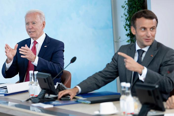 File: Emmanuel Macron, in a phone call with Joe Biden, underscored the 'collective moral responsibility toward the Afghan men and women who need our protection' (AP)
