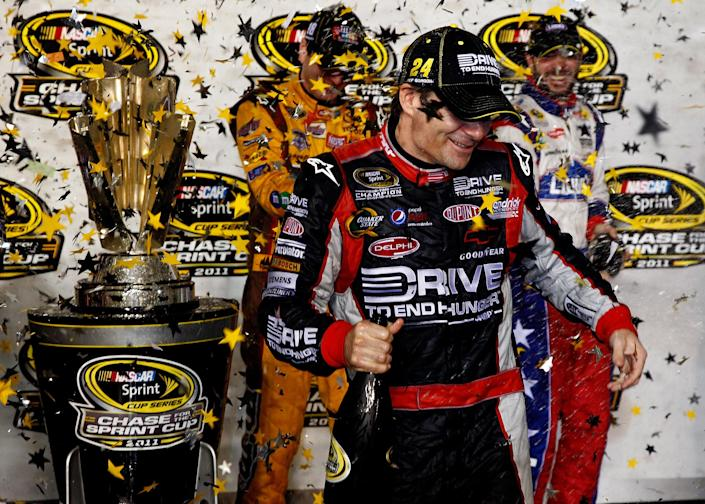 """RICHMOND, VA - SEPTEMBER 10: Jeff Gordon, driver of the #24 Drive to End Hunger Chevrolet, celebrates with Kyle Busch, driver of the #18 M&M's Toyota, and Jimmie Johnson, driver of the #48 Lowe's/Power of Pride Chevrolet, after clinching spots in the """"Chase for the Sprint Cup"""" following the NASCAR Sprint Cup Series Wonderful Pistachios 400 at Richmond International Raceway on September 10, 2011 in Richmond, Virginia. (Photo by Jeff Zelevansky/Getty Images)"""