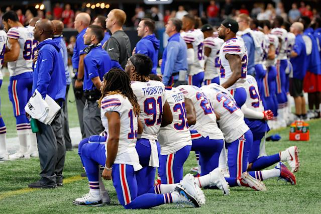 <p>Buffalo Bills players kneel during the national anthem prior to the first half against the Atlanta Falcons at Mercedes-Benz Stadium on October 1, 2017 in Atlanta, Georgia. (Photo by Kevin C. Cox/Getty Images) </p>