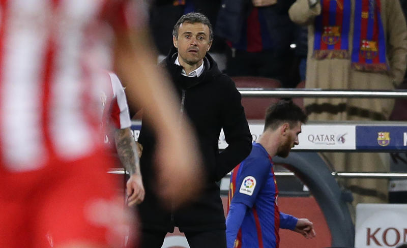 FC Barcelona's coach Luis Enrique, center, stands next Lionel Messi after been substituted during the Spanish La Liga soccer match between FC Barcelona and Sporting Gijon at the Camp Nou stadium in Barcelona, Spain, Wednesday, March 1, 2017. Luis Enrique says he will not stay as Barcelona coach after this season. The surprise announcement was made following the team's 6-1 win over Sporting Gijon in the Spanish league on Wednesday. (AP Photo/Manu Fernandez)