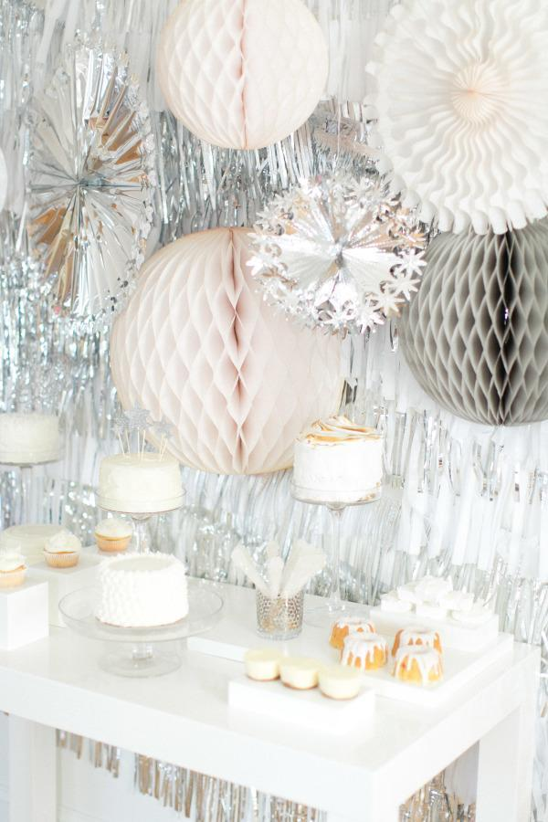 """<p>New Year's Eve is the one day your decor theme can incorporate shine, shine and more shine. This party from <a rel=""""nofollow noopener"""" href=""""http://www.stylemepretty.com/vault/image/1285164"""" target=""""_blank"""" data-ylk=""""slk:Style Me Pretty Living"""" class=""""link rapid-noclick-resp"""">Style Me Pretty Living</a> features a myriad of shiny silver decorations, anchored by a plain white table with treats. </p>"""