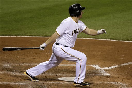 Pittsburgh Pirates' Travis Snider hits a grand slam off Chicago Cubs relief pitcher Shawn Camp during the sixth inning of a baseball game in Pittsburgh Tuesday, May 21, 2013. (AP Photo/Gene J. Puskar)