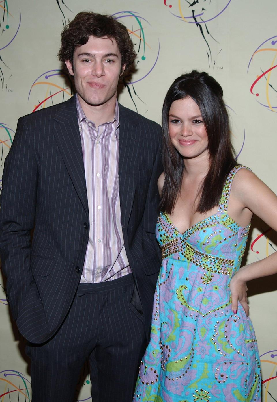 """<p>While filming <strong>The O.C.</strong>, Adam and Rachel's onscreen romance led to an IRL relationship, though the actors decided to split after three years of dating. However, they continued to play Seth and Summer until the show ended in 2007, and their characters even got married. </p> <p>The former couple has kept quiet about their on-set relationship post-breakup, but a run-in at an airport proved that there's no bad blood between the two. In August 2019, <a href=""""http://www.instagram.com/p/B1IQ2STAv4a/"""" class=""""link rapid-noclick-resp"""" rel=""""nofollow noopener"""" target=""""_blank"""" data-ylk=""""slk:Rachel posted an Instagram"""">Rachel posted an Instagram</a> from JFK, where she coincidentally ran into her ex. """"Ran into my ol buddy from jfk to lax #californiaherewecome,"""" she captioned the selfie. </p>"""