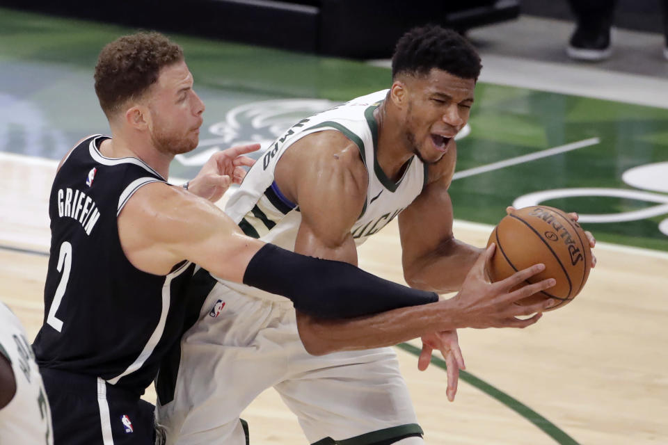 Milwaukee Bucks' Giannis Antetokounmpo is fouled by Brooklyn Nets' Blake Griffin during the second half of an NBA basketball game Tuesday, May 4, 2021, in Milwaukee. (AP Photo/Aaron Gash)